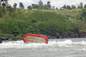 Raft flipping in water