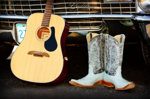 Country music with guitar and boots
