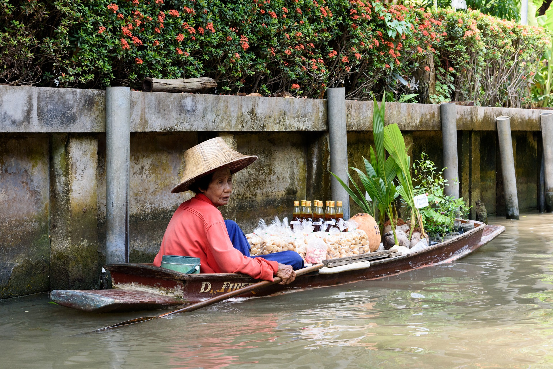 Vendor on the floating market in Thailand.