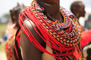Compass - African woman with beaded necklace.jpg