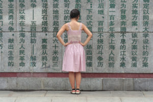 Girl at wall in China.jpg