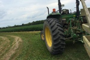 Tracker trailer pulling group through an apple farm on agritourism trip. Photo: Tonya Fitzpatrick