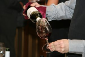 Pouring wine into a glass for tasting