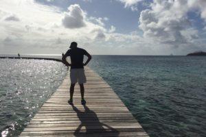Photo of Ian reflecting on the water. Photo: Tonya Fitzpatrick