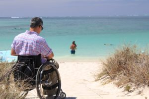 Wheelchair traveler at the beach.