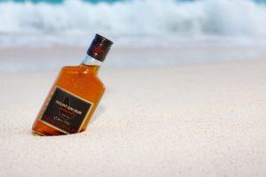 Mount Gay rum in sand