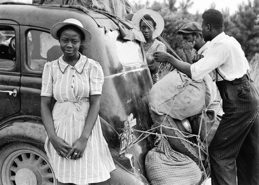 African American family traveling by car during segregation.