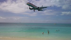 Caribbean plane and swimmers