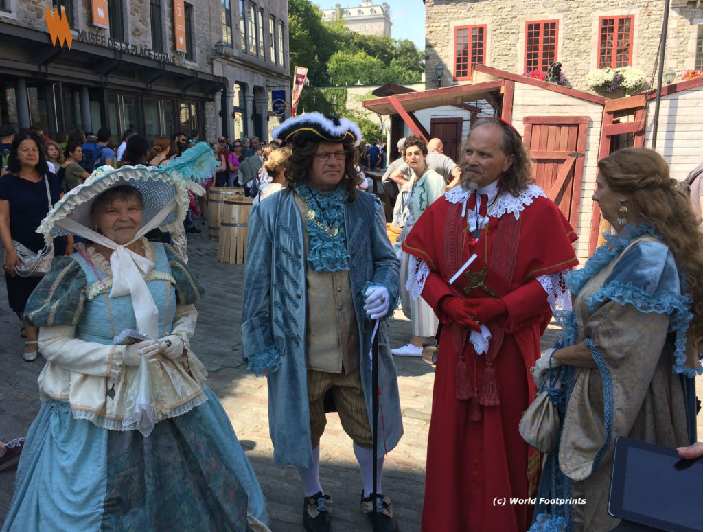 New France festivalgoers dressed in period costumes