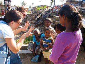 Volunteers teaching numbers in a Sri Lankan tsunami camp. Photo: Julie Hatfield