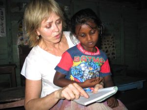 The author helping a student with her English lesson. Photo: Tim Leland
