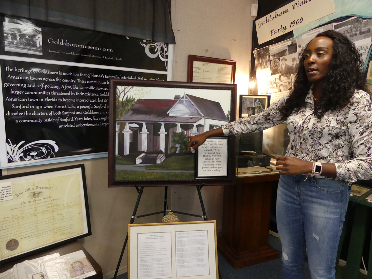 Pasha shows us an exhibit of the Boykin home and post offfice that once stood on this site. Photo: Kathleen Walls