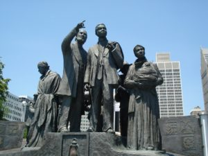 This mural honors the underground railroad. The figures are facing Ontario, Canada from the Detroit Riverwalk.