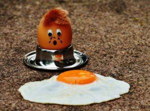 Fried egg on sidewalk