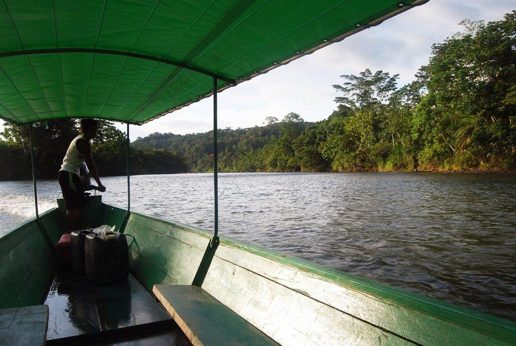 Ecuador Amazon. Driver on the river.