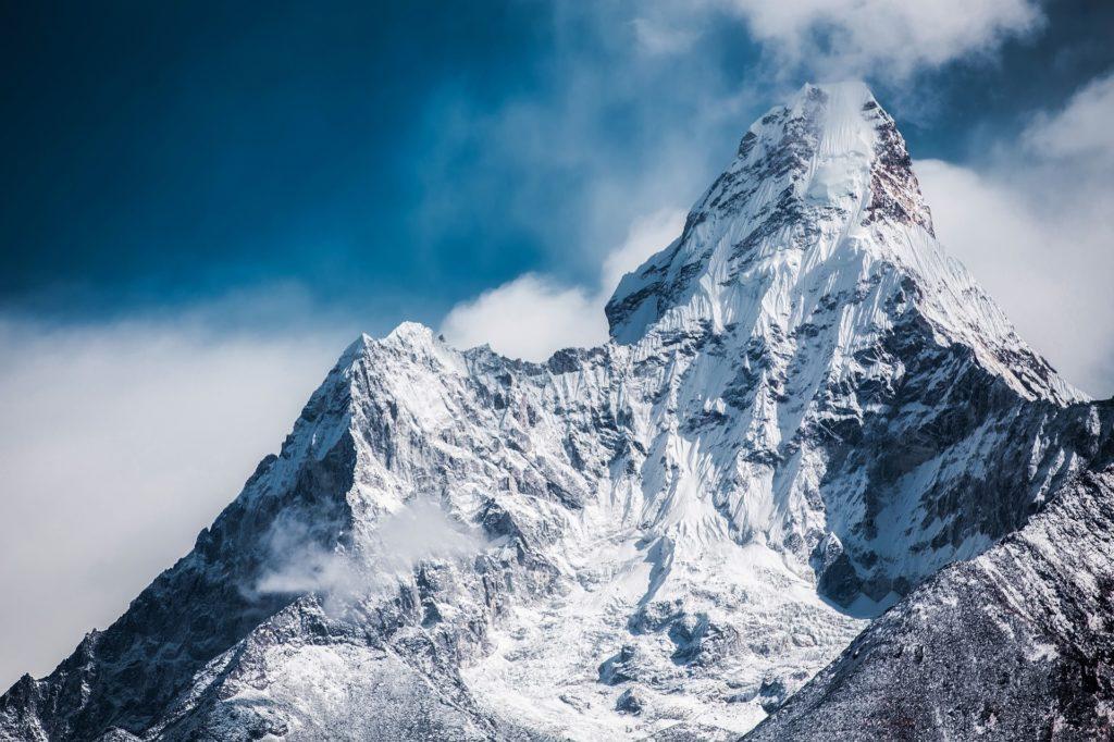 Ama Dablam is a mountain in the Himalaya range of eastern Nepal. The main peak is 6,812 metres, the lower western peak is 6,170 metres.