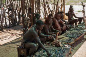 Himba tribe members displaying their wares.