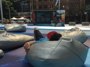 Festival goer having a rest on a moon rock in between activities. Photo: Ann-Marie Cahill