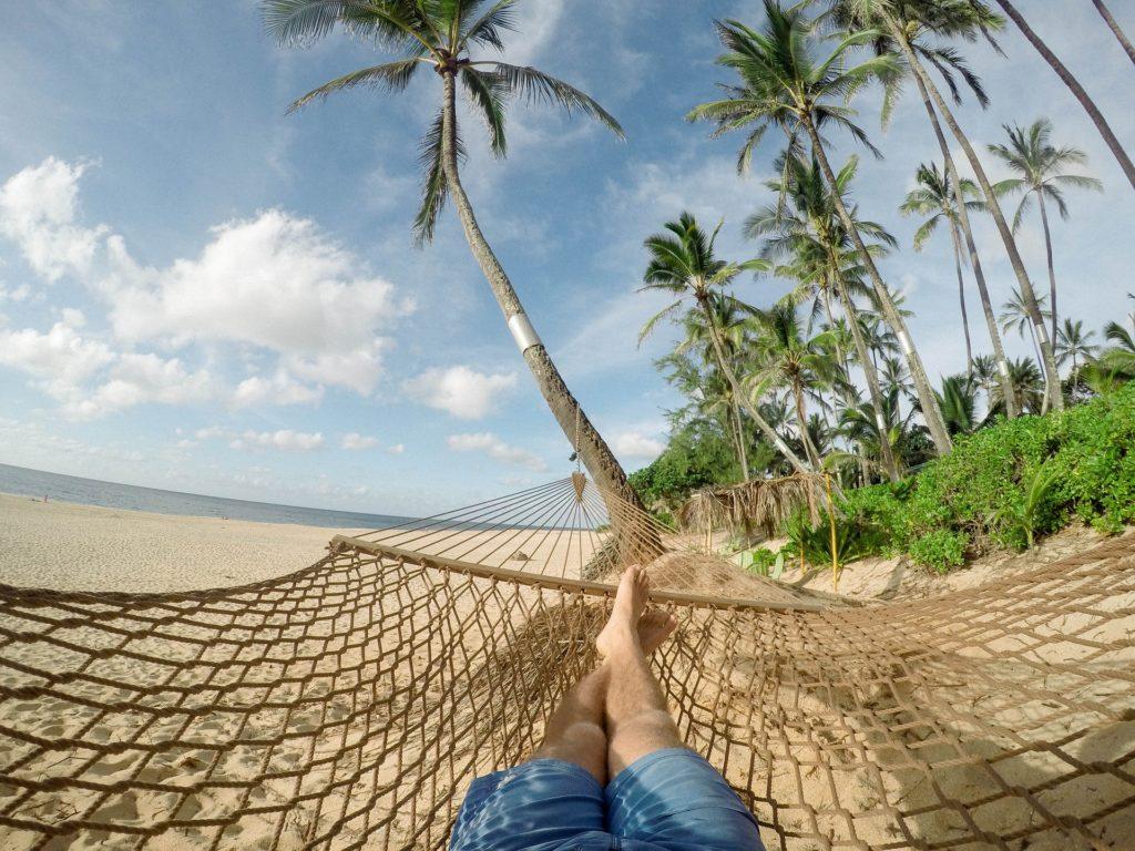 Relaxing on a beach hammock