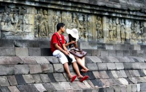 A couple enjoying quiet time and the internet in Indonesia.