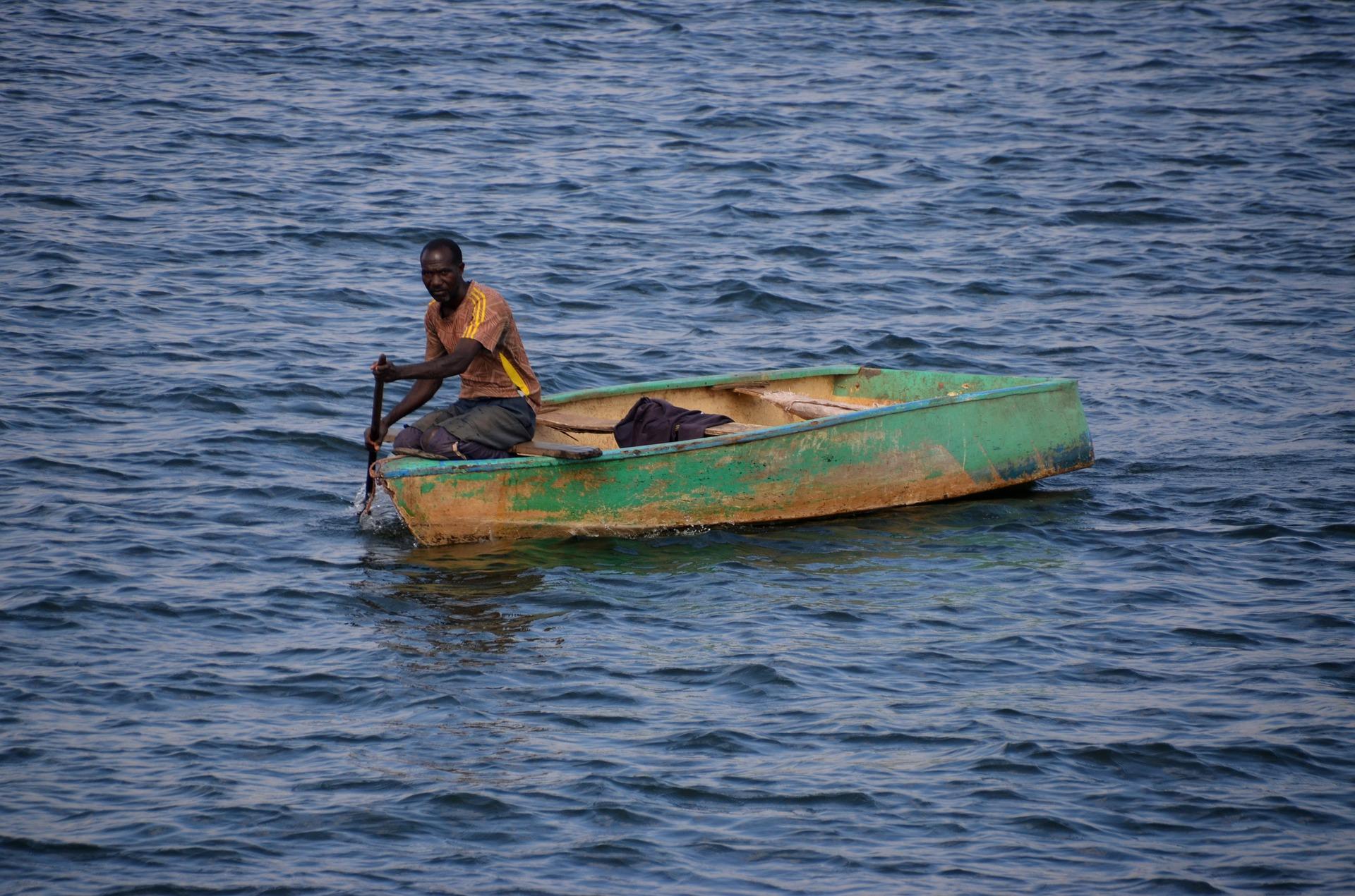 Man in a fishing boat on Lake Karibasee in Zimbabwe.