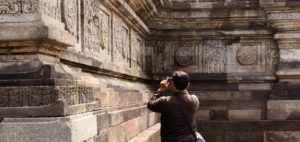 A tourist taking a photo in Java.
