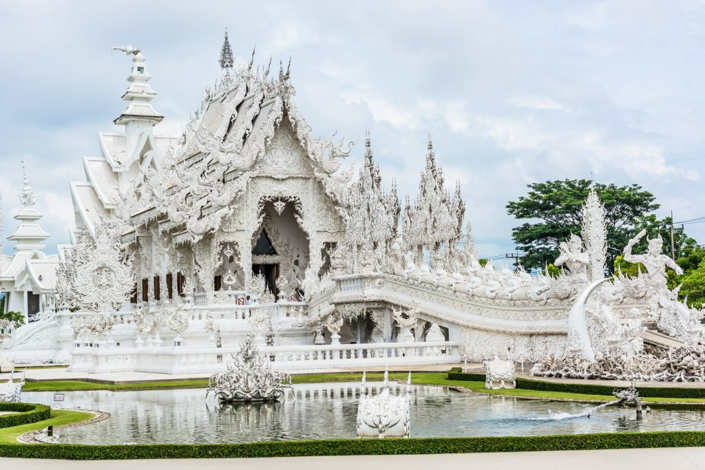 The White Temple (Wat Rong Kun), is a privately-owned art exhibit inside a Buddhist temple styled contemporary building. The unconventional building was opened to the public in 1997 by designer and owner Chalermchai Kositpipat.