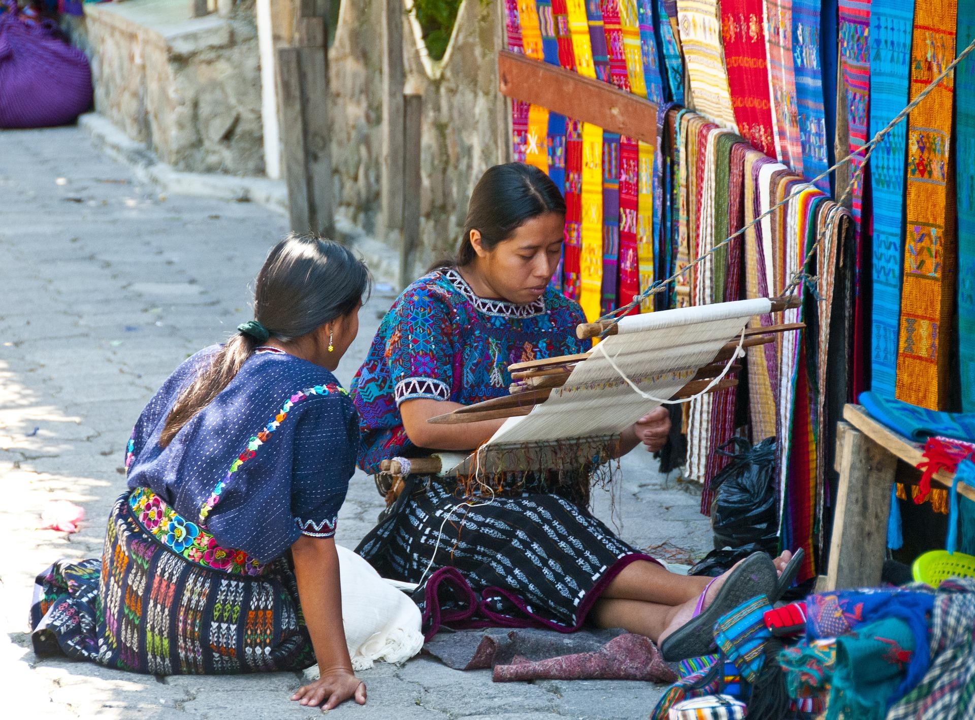 Mayan women enjoying their craft of weaving.