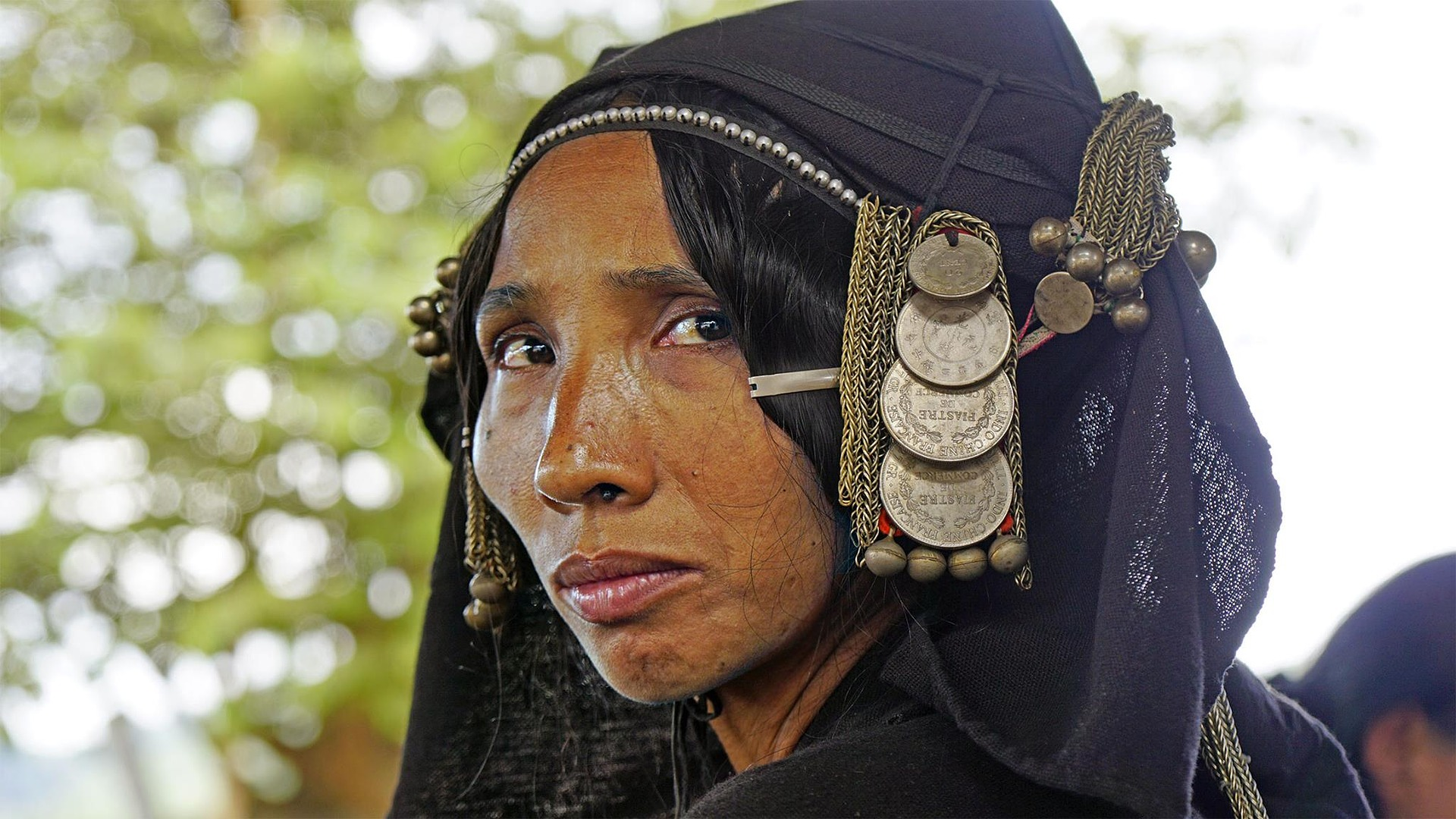 Oma Woman in Laos wearing a fashion style that was appropriated by fashion design house Max Mara.