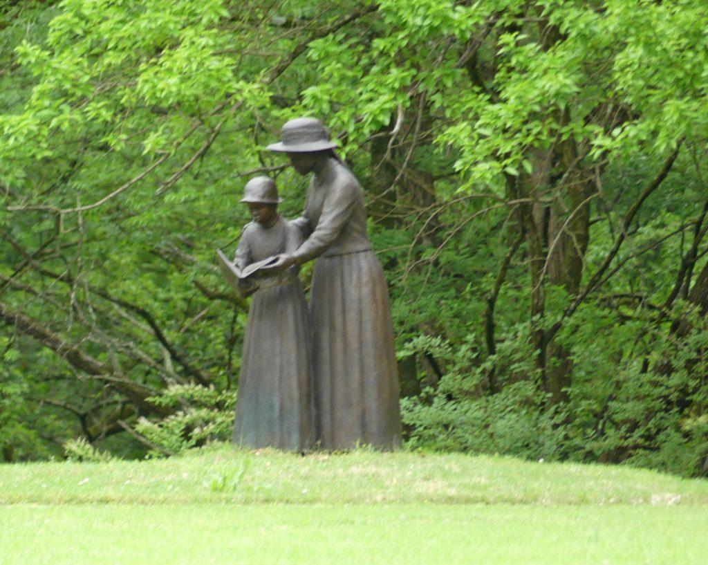 Bronze sculptures depict reading lessons. Photo: Kathleen Walls