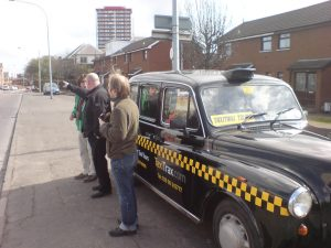 Black Taxi offering tours in West Belfast. Photo courtesy of Creative Commons.