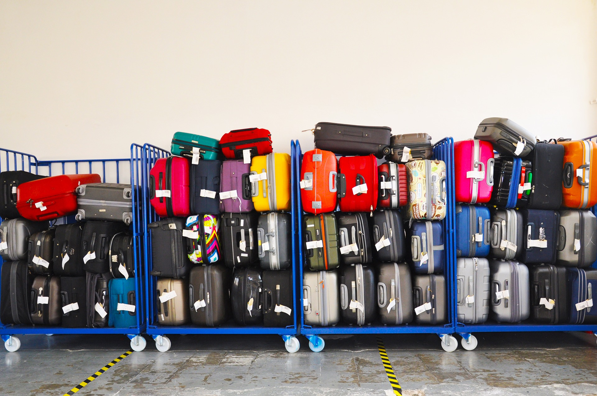 Luggage pile waiting to be loaded on plane.