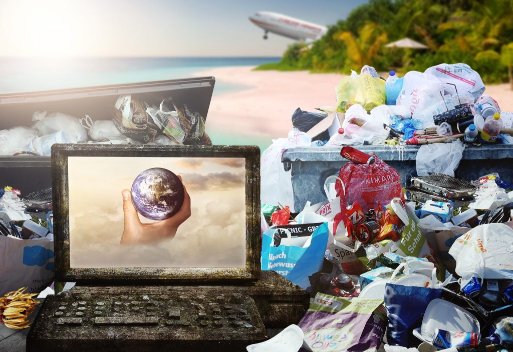 Green Travel - Pile of plastic rubbish on a tropical beach with a plane taking off in the background.