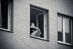 Girl looking out of a window