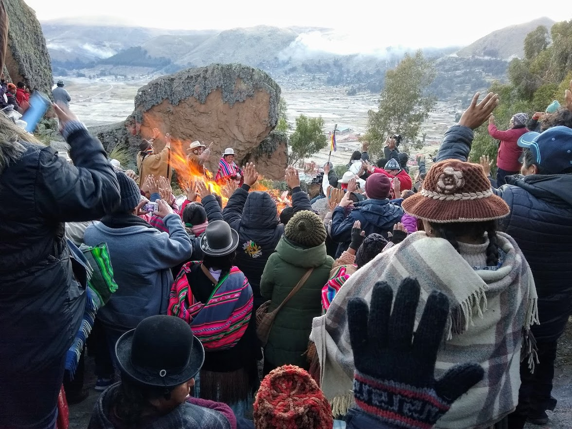 Photo credit: Renee Alexander / Sun worshipers welcome the Winter Solstice sunrise with raised hands and open hearts.