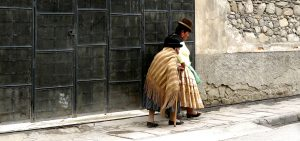 Cholita walking in La Paz