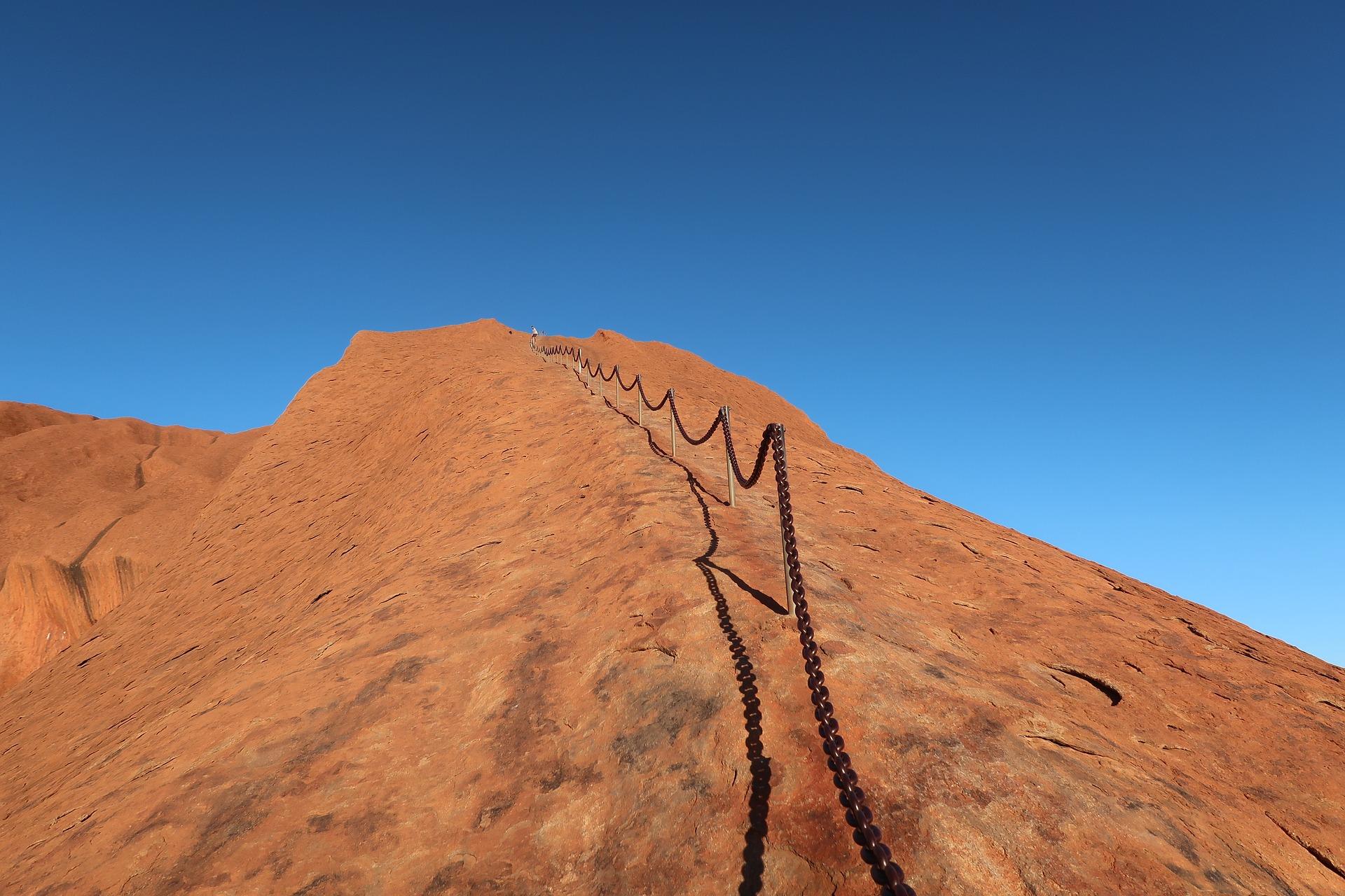 Rock climb chain on Uluru.