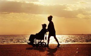 Wheelchair traveler on a beach