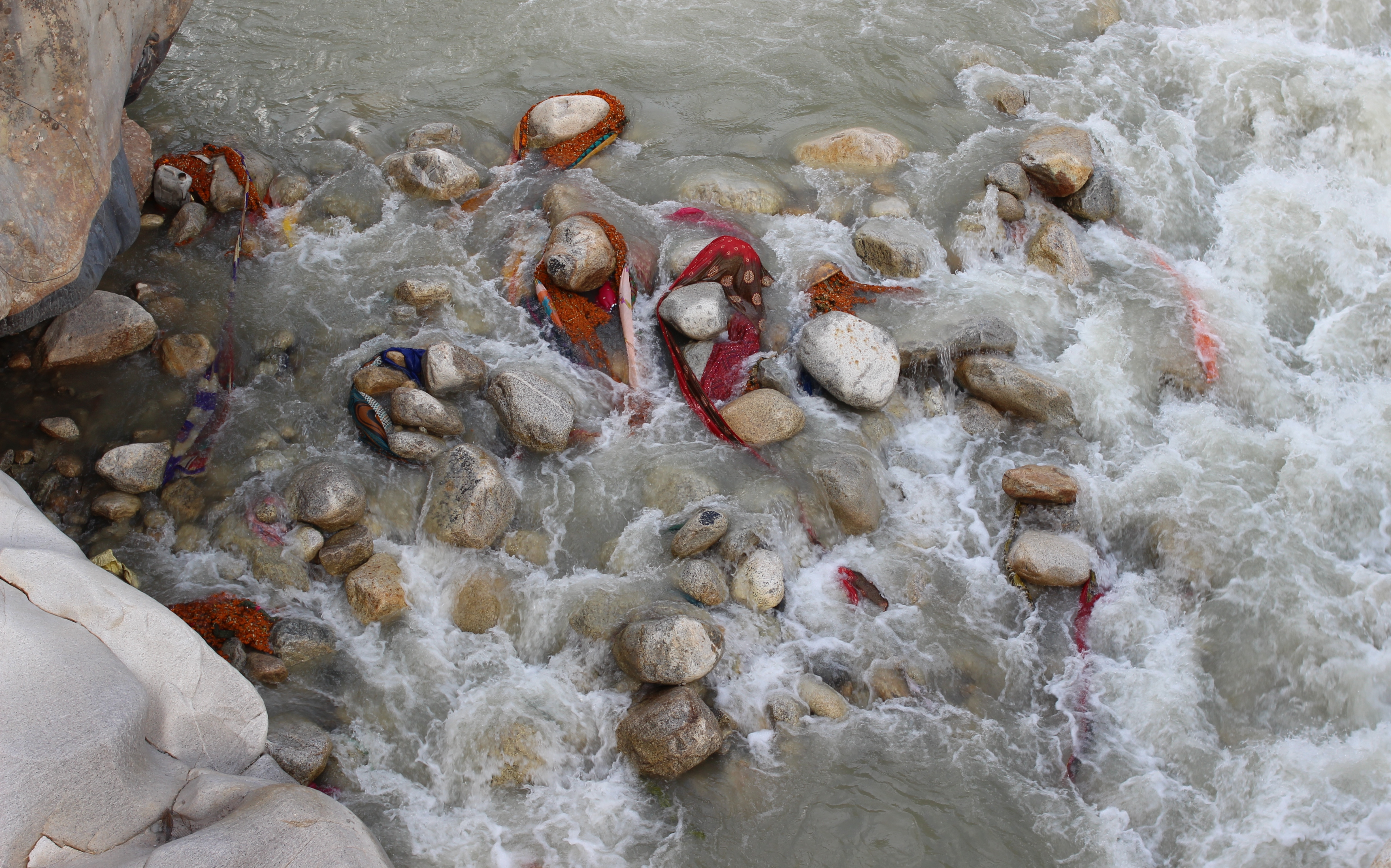 Articles of clothing and saris lost to the river by ritual bathers. Photo: Trixie Pacis