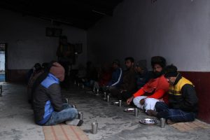 Author sitting for dinner at the ashram