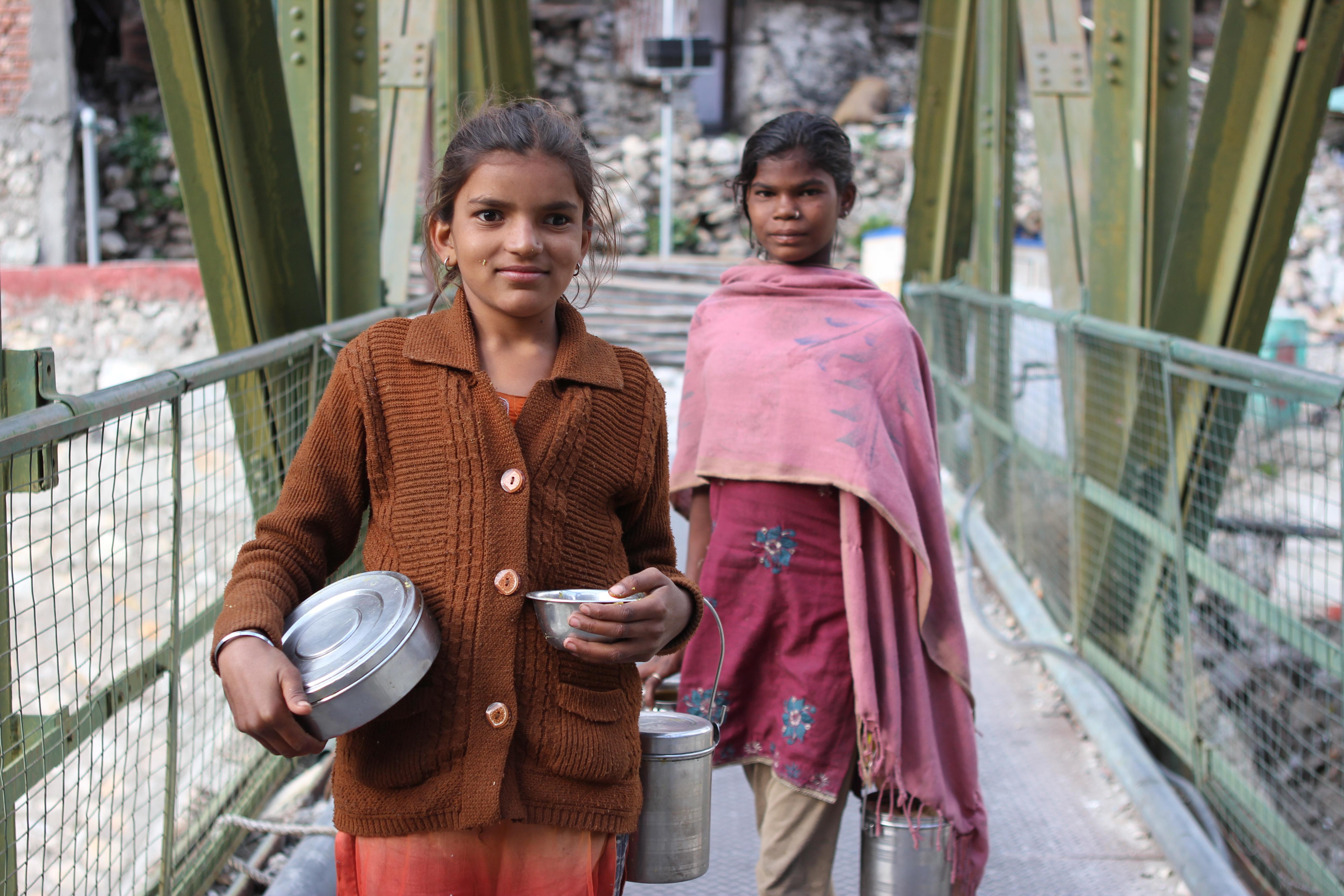 The two girls and their tiffin boxes on Gangotri's main (but totally tiny) bridge. Photo: Trixie Pacis