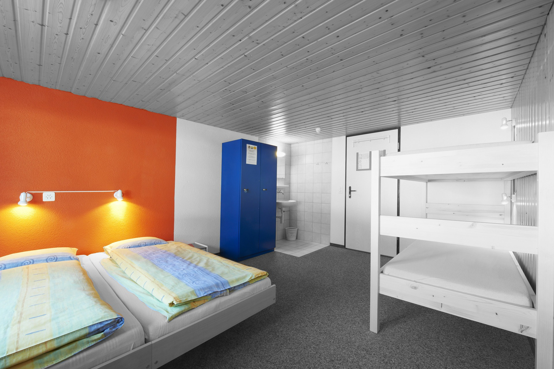 Beds in a hostel dorm room is a common sleeping place for digital nomads.