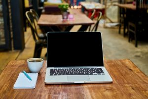 coffee laptop in cafe is the desk of a digital nomad