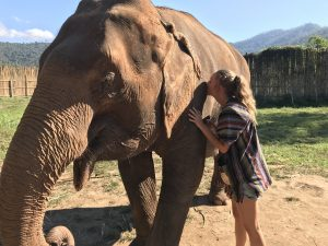Author Chelsea Wiersma with elephant friend at a reserve.
