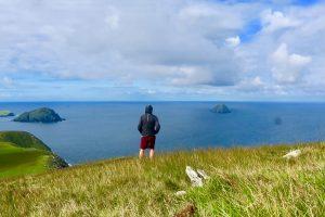 Derek Cullen overlooking the habor on the Great Blasket Island in Irleland