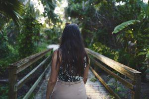 Walking across a bridge in the forest