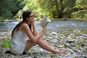 girl-reading by brook