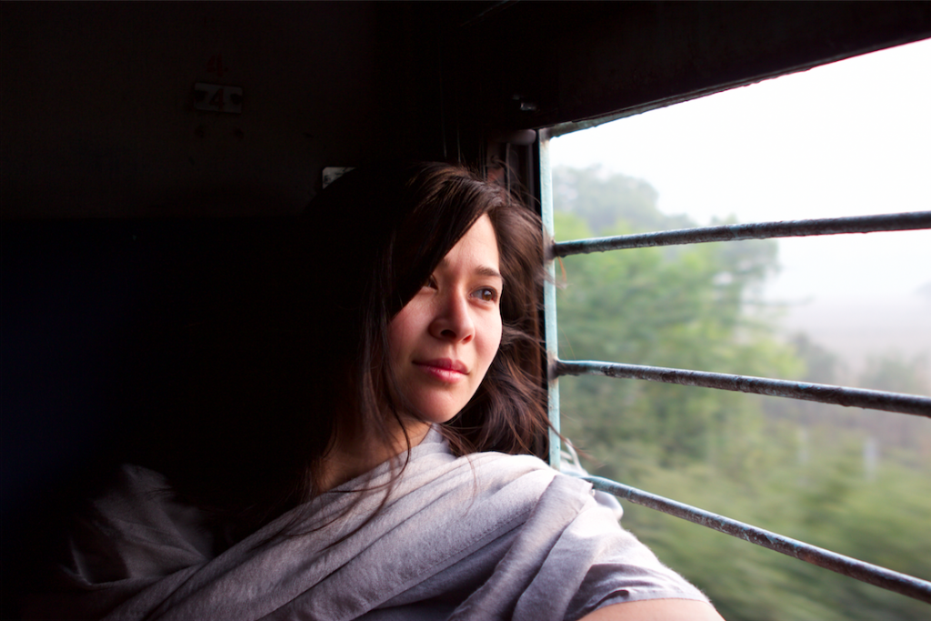 Trixie Pacis gazing out a window in India