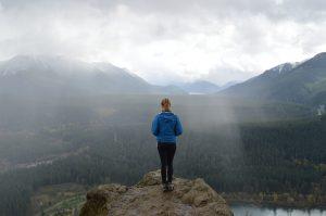 Woman traveler on mountain top