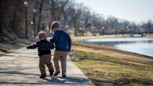 Brothers walking along a path